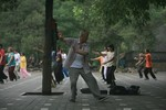 BEIJING - JULY 31:  Beijing residents practice...