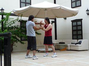 English: Mehmet Tekin Praciticing Chi Sao with...